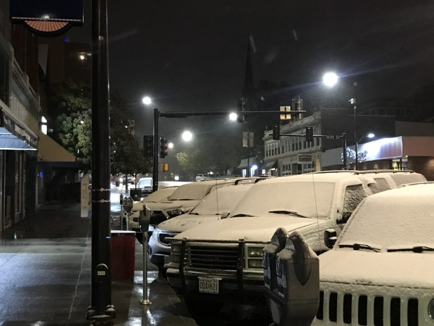 Snow on cars in downtown Columbia